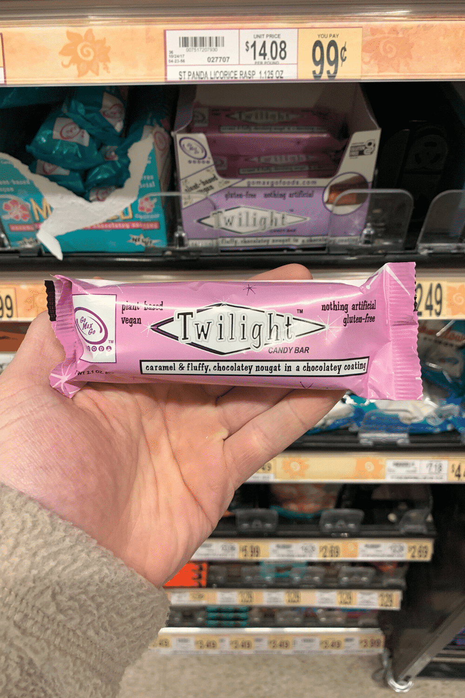 A hand holding a Twilight vegan candy bar