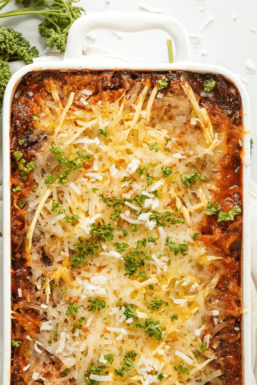 A white baking dish filled with vegan lasagna.