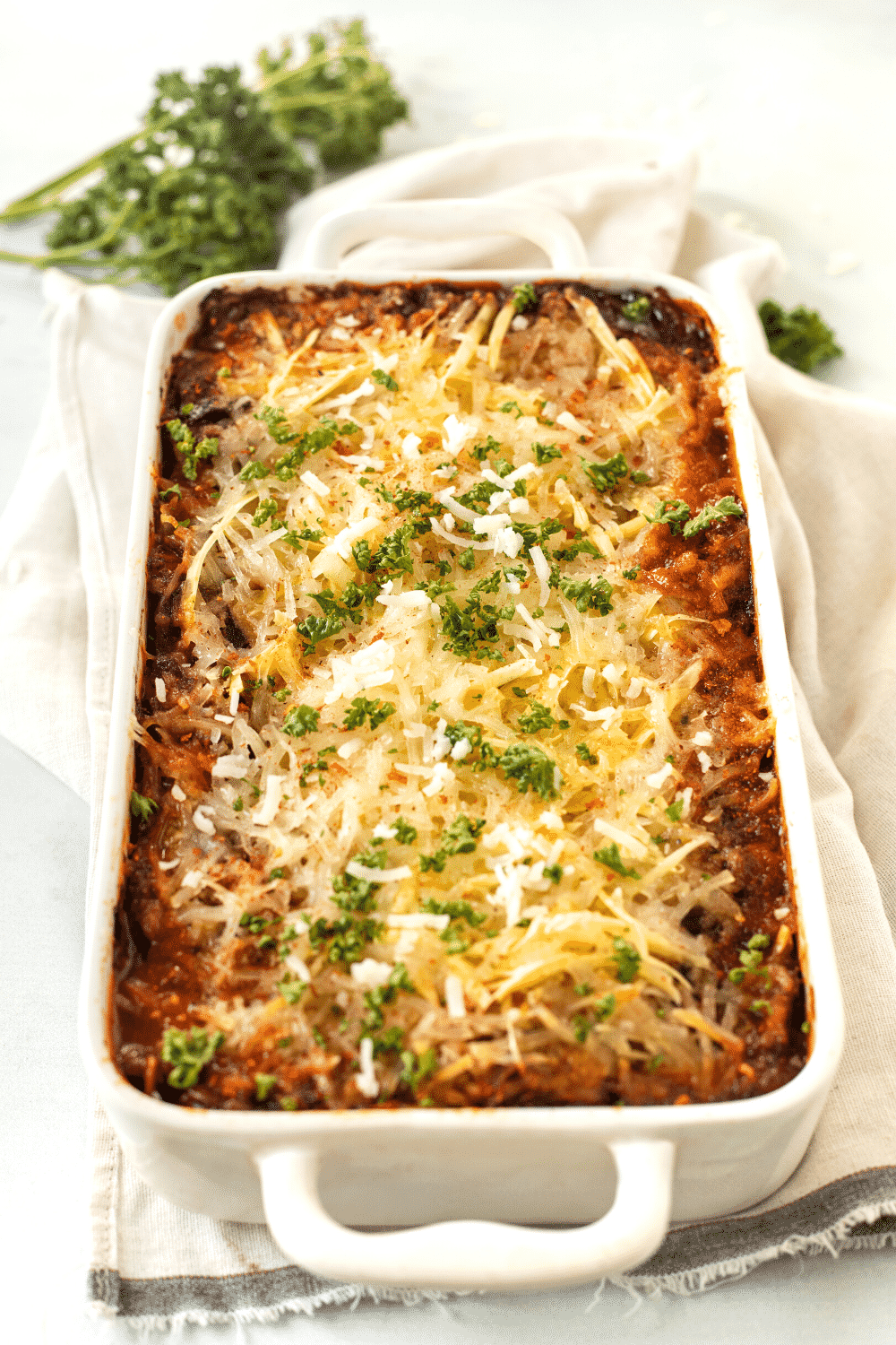 A white baking dish with vegan lasagna in it.