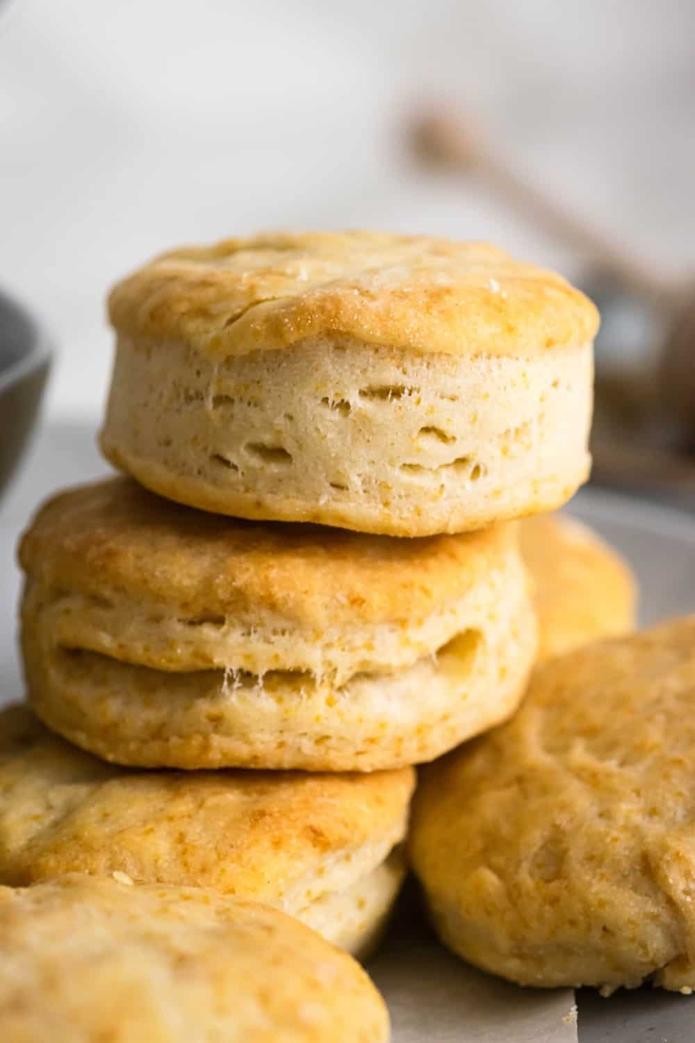 Two biscuits stacked on top of a few other biscuits.