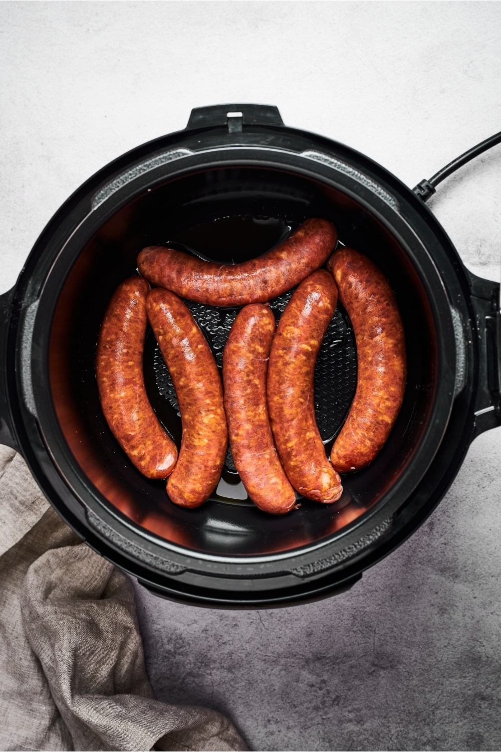 Six Italian sausages in an instant pot.
