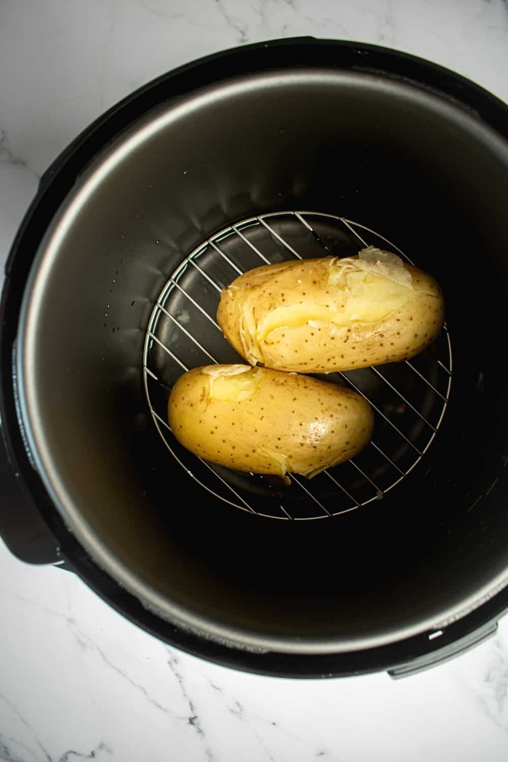 Two potatoes in an instant pot.